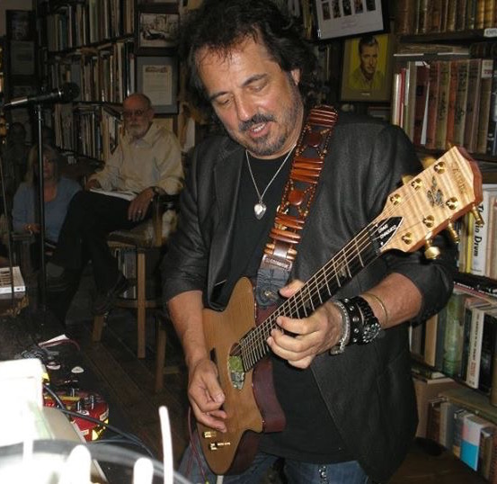 Craig Playing at Booksigning