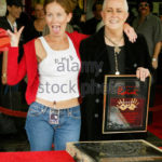 "Grace Slick, lead singer of rock groups ""Jefferson Airplane,"" ""Jefferson Starship,"" and ""Starship,"" poses with her daughter China Kantner (L) after Slick's induction into Hollywood's Rock Walk, October 22, 2002 in Hollywood. Slick, best known for her song ""White Rabbit,"" was one of the first female rock stars in the 1960's and 1970's and currently devotes her time to painting. REUTERS/Fred Prouser FSP/HB"